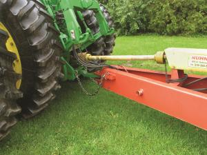 A power take off (PTO) shaft (yellow) connects the tractor to a trailed implement.   A PTO transfers mechanical power from a tractor to farm machinery, such as a mower, manure spreader or grain auger.  Credit: Canadian Agricultural Safety Association; used with permission.