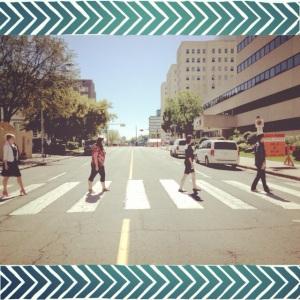 Calissa, Brenna, Angela and Dylan walk across a pedestrian crosswalk, Abbey Road style.