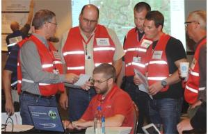 """""""An operations crew participates in a staged emergency management exercise that was created by the Canadian Energy Pipeline Association and its member companies, at the Edmonton Expo Centre on Wednesday, Sept. 24, 2014. The exercise is meant to prepare its workers for any potential oil spills."""" Photograph by:Ed Kaiser, Edmonton Journal"""